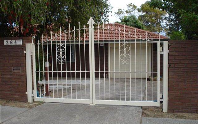 Cream Wrought Iron Driveway Gate